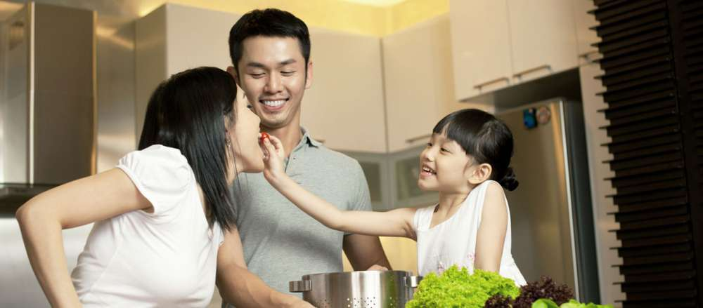 asian-family-daughter-feeding-mum.jpg